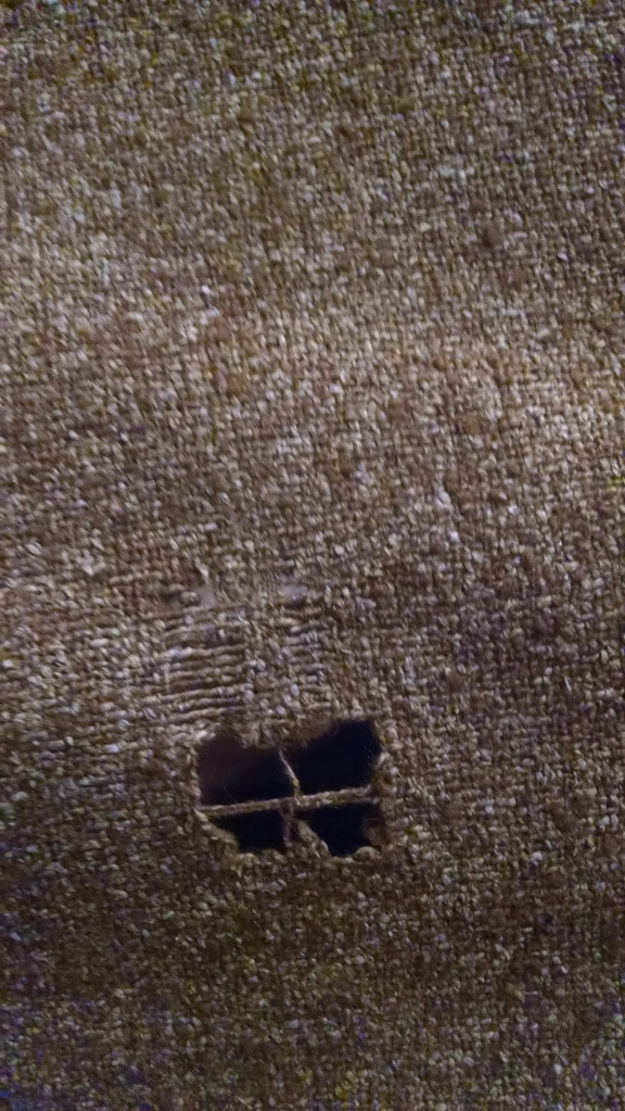 ratty-spot-in-tweed-fabric